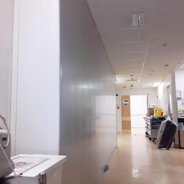 Temporary floor-to-ceiling hospital wall