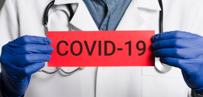 Doctor holding COVID-19 sign